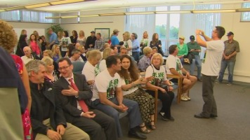 Edina parents gather ahead of an Edina School Board meeting to show their support for Vice Chair Sarah Patzloff.